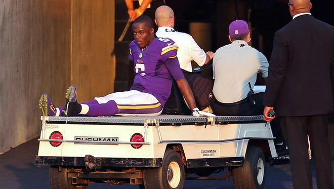 Minnesota Vikings quarterback Teddy Bridgewater (5) is carted off the field following an injury during the fourth quarter against the Atlanta Falcons at TCF Bank Stadium. The Vikings defeated the Falcons 41-28.