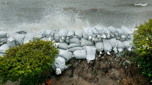 Sandbags along lakefront properties on Newco Drive in Hamlin on May 5, 2017.