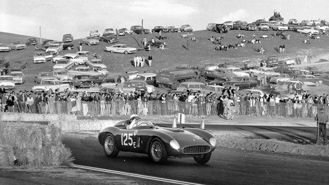Pete Lovely took home the inaugural victory at Laguna Seca on Nov. 10, 1957, as a huge underdog in a 1956 Ferrari Testa Rossa. The original car was featured in the Racing Through the Decades display at this year's Rolex Monterey Motorsports Reunion.