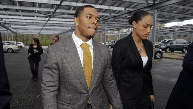 Baltimore Ravens football player and former Rutgers University standout, Ray Rice holds hands with his wife Janay Palmer as they arrive at Atlantic County Criminal Courthouse in Mays Landing, N.J., Thursday, May 1, 2014. After Rice and Janay Palmer got into a physical altercation on Feb. 15 at an Atlantic City casino, both were charged with simple assault-domestic violence. (AP Photo/Mel Evans)