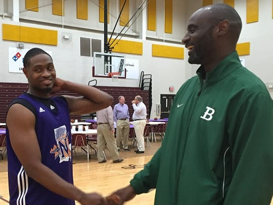 NSU guard Devonte Hall, a former Bossier standout, shares a laugh with Bossier coach Jeremiah Williams at the NSU function.