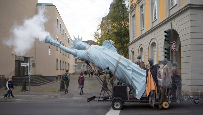 A six-meter high replica of the Statue of Liberty made by Danish artist Jens Galschiot at the 'Climate March' demonstration prior to the UN Climate Change Conference COP23, Saturday.