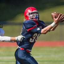Chenango Forks tight end Connor Borchardt pulls in a pass over Vestal defensive back Derek Osman during Chenango Fork's 27-0 win at home on Saturday, Sept. 24, 2016.