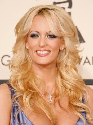In this 2008 file photo, Stormy Daniels arrives at the Grammy Awards.