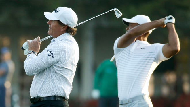 Phil Mickelson, left, and Tiger Woods have combined to win seven green jackets. After Friday, you wonder if either will win another.