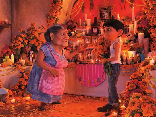 "In ""Coco,"" Miguel and his grandmother prepare for Day"