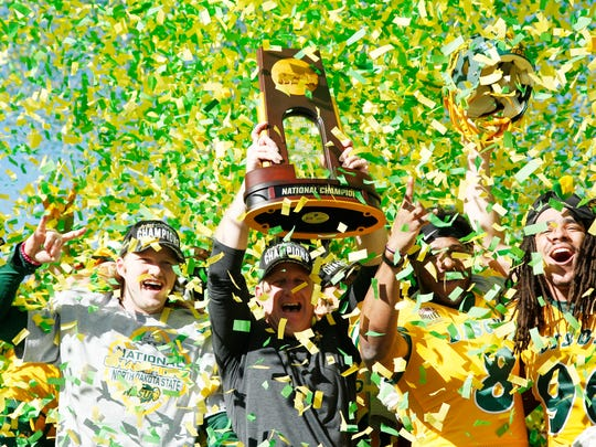 North Dakota State Bison head coach Chris Klieman holds up the FCS Championship trophy after the game against the Eastern Washington Eagles in the 2019 Division I Football Championship.
