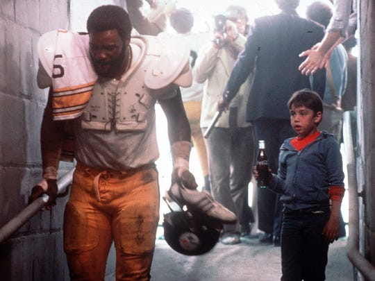 "Former Pittsburgh Steelers star and NFL Hall of Fame member ""Mean"" Joe Greene and child actor Tommy Okon appear in this still photo from a 1979 Coca-Cola television commercial."