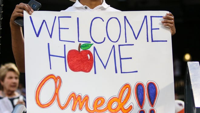A fan with a sign welcoming New York Mets shortstop Amed Rosario (not pictured) prior to the game between the Los Angeles Dodgers and the New York Mets at Citi Field.
