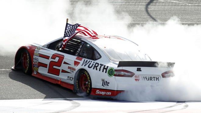 Brad Keselowski celebrates after winning the NASCAR Sprint Cup Series auto race in Fontana, Calif., Sunday, March 22, 2015.