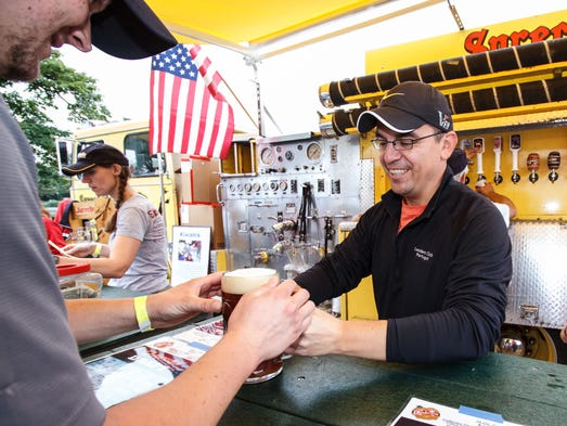 Waukesha Kiwanis member Miguel Ocampo serves up a stein