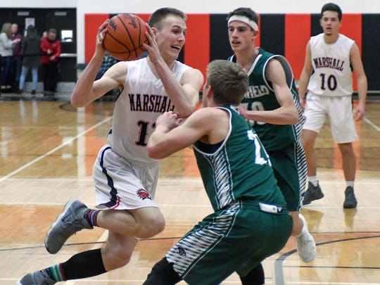 Marshall's Jack Luciani (11) drives the court during