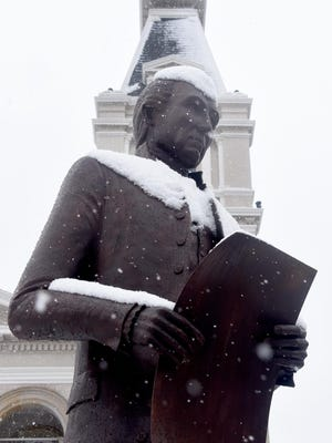 The James Monroe statue in front of the Monroe County Courthouse is pictured in downtown Monroe.