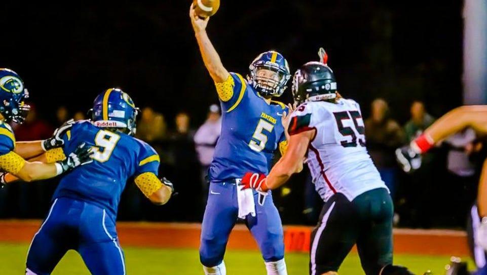 DeWitt quarterback Will Nagel ,5, throws over St. Jiohns