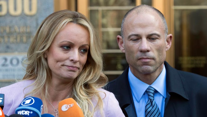 Adult film actress Stormy Daniels, left, stands with her lawyer Michael Avenatti as she speaks outside federal court Monday,