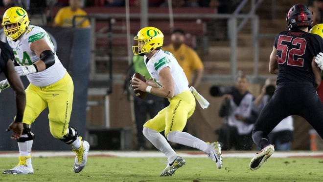 Oct 14, 2017; Stanford, CA, USA; Oregon Ducks quarterback Braxton Burmeister (11) scrambles with the football against the Stanford Cardinal during the first quarter at Stanford Stadium. Mandatory Credit: Neville E. Guard-USA TODAY Sports