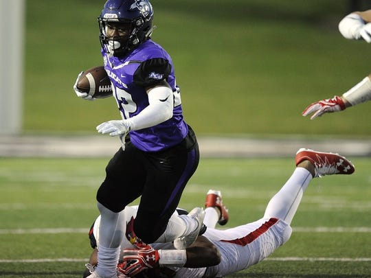 Thomas Metthe/Reporter-News Abilene Christian running back De'Andre Brown (22) gets tripped up by a Lamar defender during the third quarter of the Wildcats' 38-10 loss on Saturday, Oct. 8, 2016, at Shotwell Stadium.