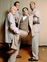 "Greg Longenhagen (center) in a scene from Florida Rep's 2005 production of  ""My Three Angels."" Also pictured, from left, are Niels Miller, Zolan Henderson and Jim Van Valen."