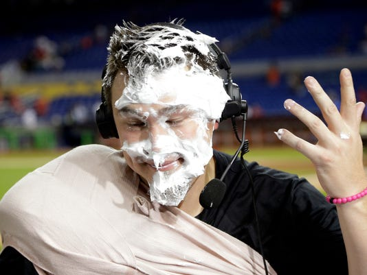Miami Marlins starting pitcher Vance Worley does an interview after being covered with shaving cream, after the Marlins defeated the Washington Nationals 7-0 in a baseball game, Wednesday, Aug. 2, 2017, in Miami. (AP Photo/Lynne Sladky)