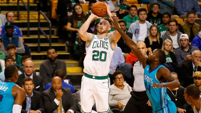 Oct 2, 2017; Boston, MA, USA; Boston Celtics forward Gordon Hayward (20) shoots past Charlotte Hornets forward Michael Kidd-Gilchrist (14) during the first half of a preseason game at TD Garden.