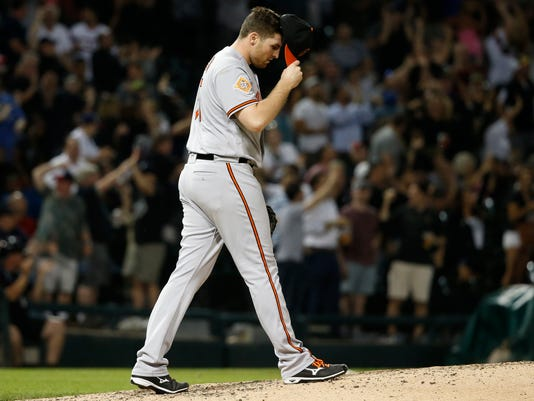 Baltimore Orioles starting pitcher Alec Asher reacts after giving up a grand slam to Chicago White Sox's Matt Davidson during the sixth inning of a baseball game Tuesday, June 13, 2017, in Chicago. (AP Photo/Charles Rex Arbogast)