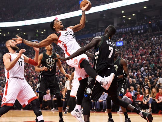 Toronto Raptors guard DeMar DeRozan (10) loses control of the ball as Milwaukee Bucks forward Thon Maker (7) defends during the first half of the opening game of an NBA basketball playoff series, in Toronto on Saturday, April 15, 2017. (Frank Gunn/The Canadian Press via AP)