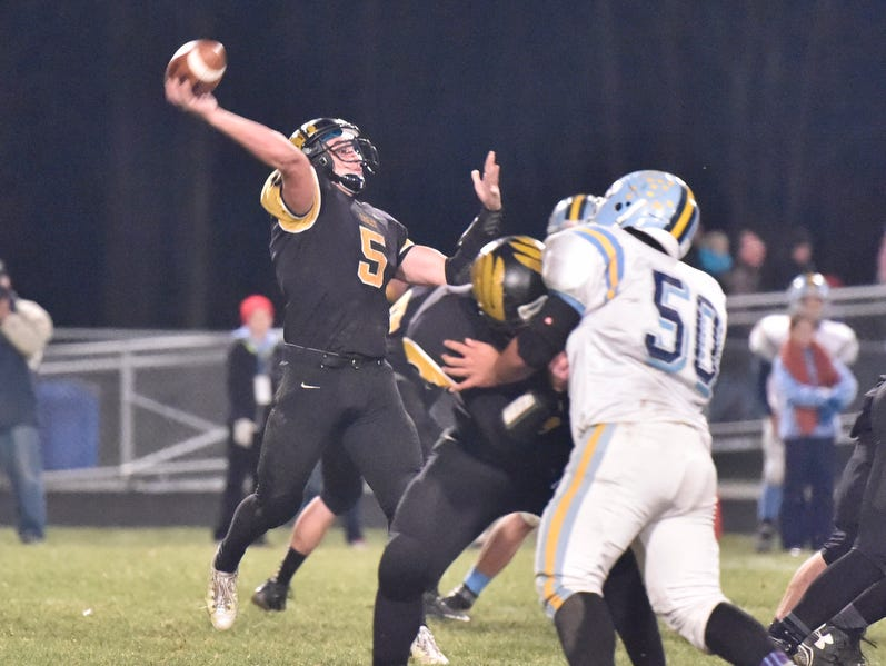 Colonel Crawford quarterback Will Kirkpatrick attempts a pass against Ayersville in a Division VI playoff football game. Kirkpatrick was named News Journal Co-Offensive Player of the Year.
