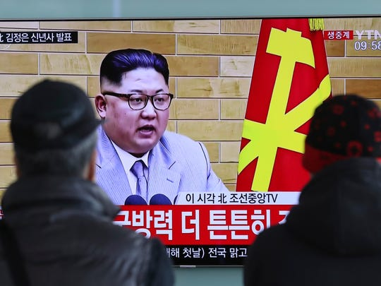 """South Koreans watch a TV news program showing North Korean leader Kim Jong Un's New Year's speech, at the Seoul Railway Station in Seoul, South Korea, Monday, Jan. 1, 2018. The letters read on top left, """"Kim Jong Un delivers New Year's speech."""" Kim said the United States should be aware that his country's nuclear forces are now a reality, not a threat."""