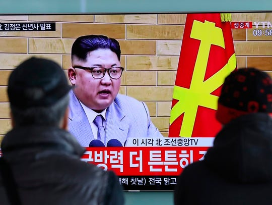 In this Jan. 1, 2018, file photo, South Koreans watch