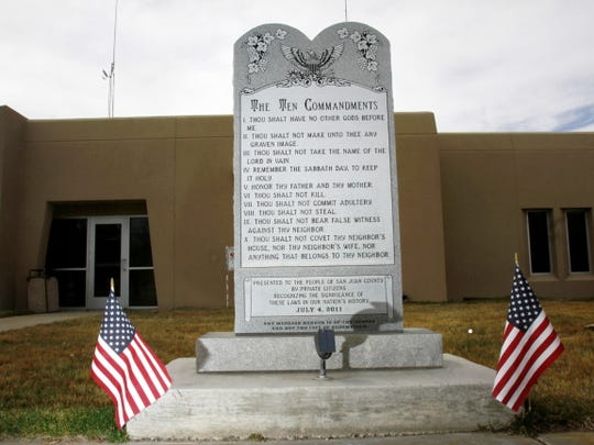 The Ten Commandments monument is seen in March 2014 in front of Bloomfield City Hall.