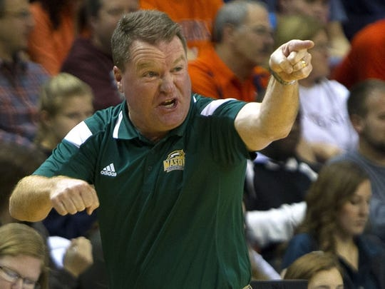 George Mason head coach Dave Paulsen reacts during the first half of a game against Virginia last season.