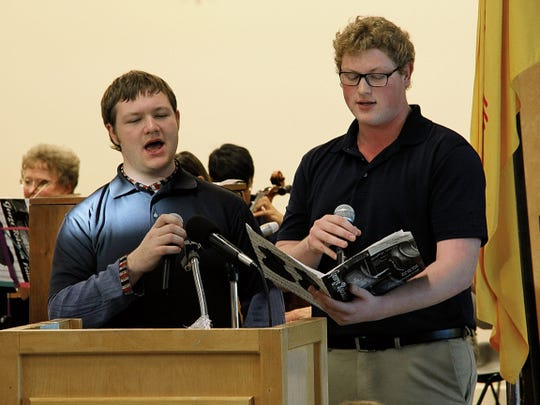 "In this 2015 file photo, Malachi Holes, 18, left, and Andrew Pitkofsky, 17, both of Imago Dei Academy, sang ""God Bless the USA"" during the 36th annual Legislative Prayer Breakfast."