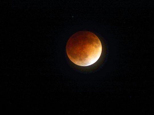 The April 15, 2014, lunar eclipse is pictured in this image captured from San Jose, Calif. Another lunar eclipse will occur Sunday.