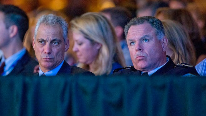 Chicago Mayor Rahm Emanuel, left, and Chicago Police Superintendent Garry McCarthy listen as President Barack Obama speaks at the International Association of Chiefs of Police at the 122nd Annual IACP Conference and Exposition in Chicago, Tuesday, Oct. 27, 2015. A Cook County judge on Thursday ordered the city release video of the Oct. 20, 2014 shooting death of Laquan McDonald, a black teenager who was shot 16 times by Chicago police officer.