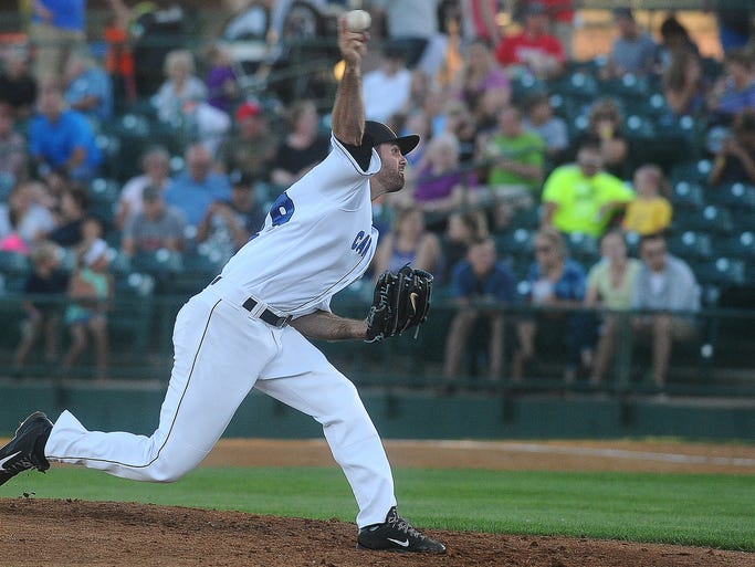 Canaries' Kyle Vazquez delivers a pitch against the New Jersey Jackals at the Birdcage on Tuesday, Aug. 12, 2014.