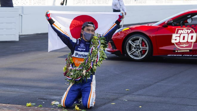 Takuma Sato of Japan celebrates after winning the Indianapolis 500 on Sunday.
