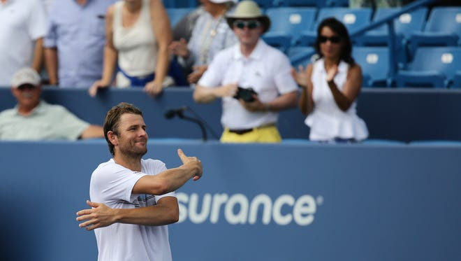 "After upsetting Viktor Troicki 6-2, 6-2 at the W&S Open, Mardy Fish showed fans his appreciation for their support with a 'hug."" Fish moves on to play World No. 2 Andy Murray."
