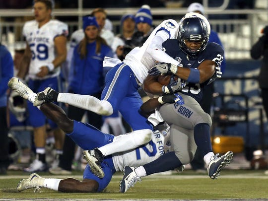 Nevada running back Kelton Moore (23) runs for a first down against Air Force last season.