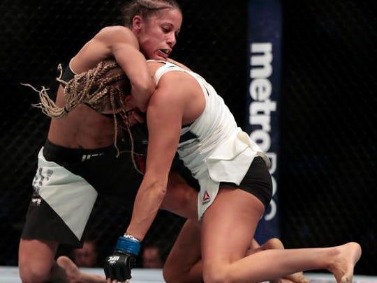 Liz Carmouche, left, grabs at Katlyn Chookagian during