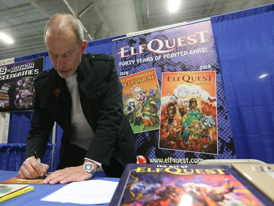 Richard Pini of Poughkeepsie signs a promotional print for ElfQuest during the Hudson Valley Comic Con in LaGrange on April 21, 2018. Pini created ElfQuest with his wife, Wendy in 1978, and after 40 years is winding down the story line.