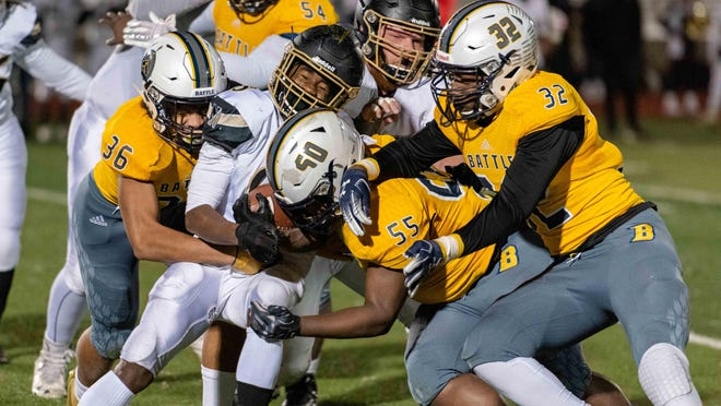 Battle defenders swarm a Francis Howell North running back during a district semifinal game last year in Columbia.