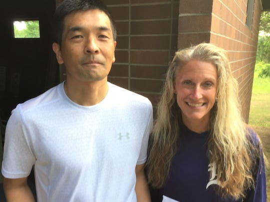 The 5K male and female masters winners at the NRR Classic at Maybury State Park were Takeshi Chicagawa (left) and Amy Masternak.
