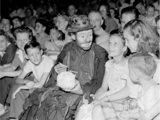 """Emmett Kelly, the world's most famous circus clown, dreamed up """"Weary Willie"""" while working as a cartoonist in 1920 for a Kansas City film company. Kelly entertained millions of circus-goers worldwide, including a delighted audience in Indianapolis on Aug. 13, 1945 (shown here). While some Indianapolis residents stayed glued to their radios that night, listening to news of Japan's surrender in World War II, others opted to attend the first of six performances under the big top tent set up on Southeastern Avenue"""