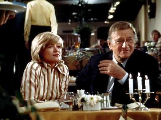 Judy Geeson and John Wayne in 'Brannigan.'