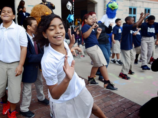 Lincoln Charter School fourth-grader Kimberly Dejesus dances with classmates during a Walk to School Day rally at the city school Wednesday, Oct. 7, 2015. The international event stresses exercise and pedestrian safety while walking and biking. The entire Lincoln student body walked a round-trip of four blocks from the school to mark the event. Bill Kalina - bkalina@yorkdispatch.com
