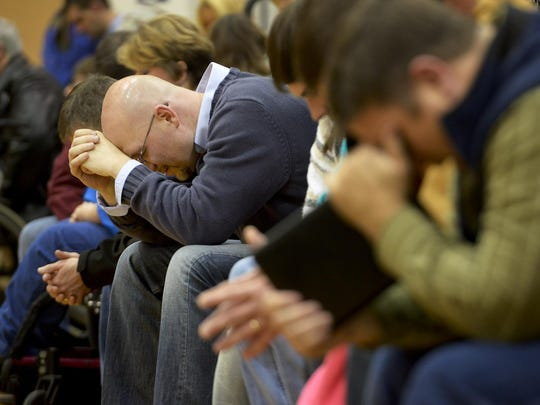 Hundreds attend a community prayer service at Chester County High School to pray for Noah Chamberlin.
