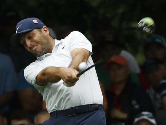 Francesco Molinari hits a drive on the seventh hole