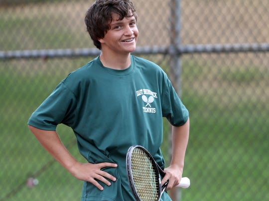 Josh Marchalik of East Brunswick smiles at the official after disagreeing with a call during the first singles sectional final match against West Windsor-Plainsboro South, Monday, May 19, 2014, in East Brunswick, NJ. Photo by Jason Towlen
