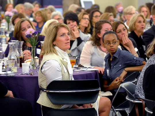 Jill Rose, center left, with the Houlihan Lawrence LaGrange office, listens to guest speaker Carolyn Everson during the Athena Leadership Luncheon Tuesday at Dutchess Community College in the Town of Poughkeepsie.