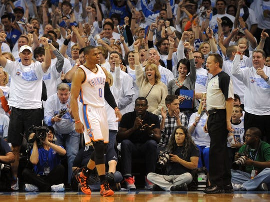 Apr 29, 2014; Oklahoma City, OK, USA; Oklahoma City Thunder guard Russell Westbrook (0) and fans react during a game at the Chesapeake Energy Arena in April 2014. Oklahoma City's NBA hopes got a boost from New Orleans' success.